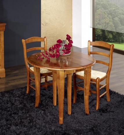 Table ronde à volets 4 pieds sabres réalisée en merisier massif de style Louis Philippe DIAMETRE 90 - 2 allonges de 40 cm