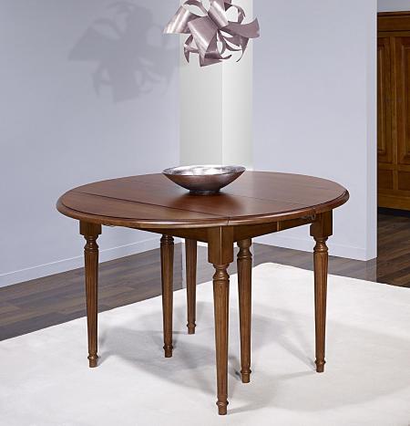 Table ronde à volets Vera réalisée en Chêne Massif de style Louis XVI avec  3 allonges de 40 cm