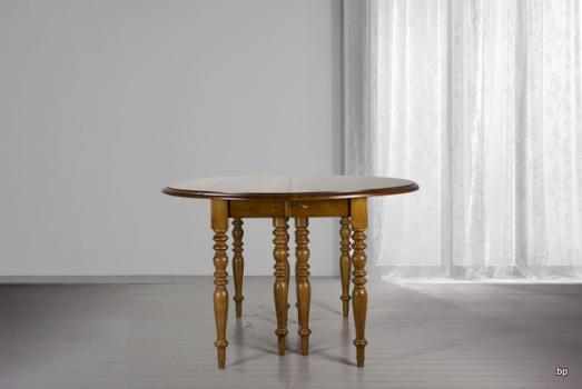 Table ronde à volets DIAMETRE 120 réalisée en merisier massif de style Louis Philippe 7 allonges de 40 cm  Table réalisée à la demande d'un client