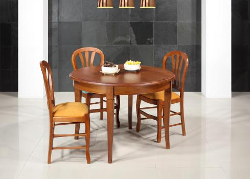 Table ronde 4 pieds -  en Chêne Massif de style Louis Philippe Diamètre 110  1 allonge portefeuille de 40 cm  Finition Chêne moyen SEULEMENT 1 DISPONIBLE