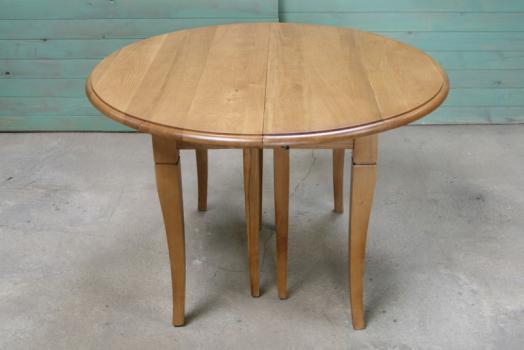 Table ronde à volets DIAMETRE 110 réalisée en Chêne massif de style Louis Philippe 5 allonges de 40 cm