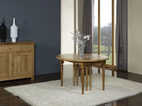 Table ronde à volets 8 pieds réalisée en Chêne Massif de style LOUIS XVI 5 allonges de 40 cm DIAMETRE 120